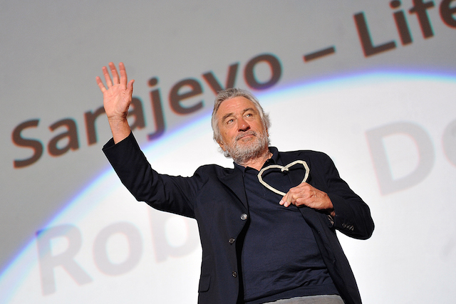 """Oscar wining actor, Robert De Niro poses after receiving """"The Heart Of Sarajevo"""" award for Lifetime Achievement in Contributing to the Art of Motion Pictures, on the opening night of the 22nd edition of Sarajevo Film Festival on August 12, 2016. / AFP PHOTO / ELVIS BARUKCIC"""